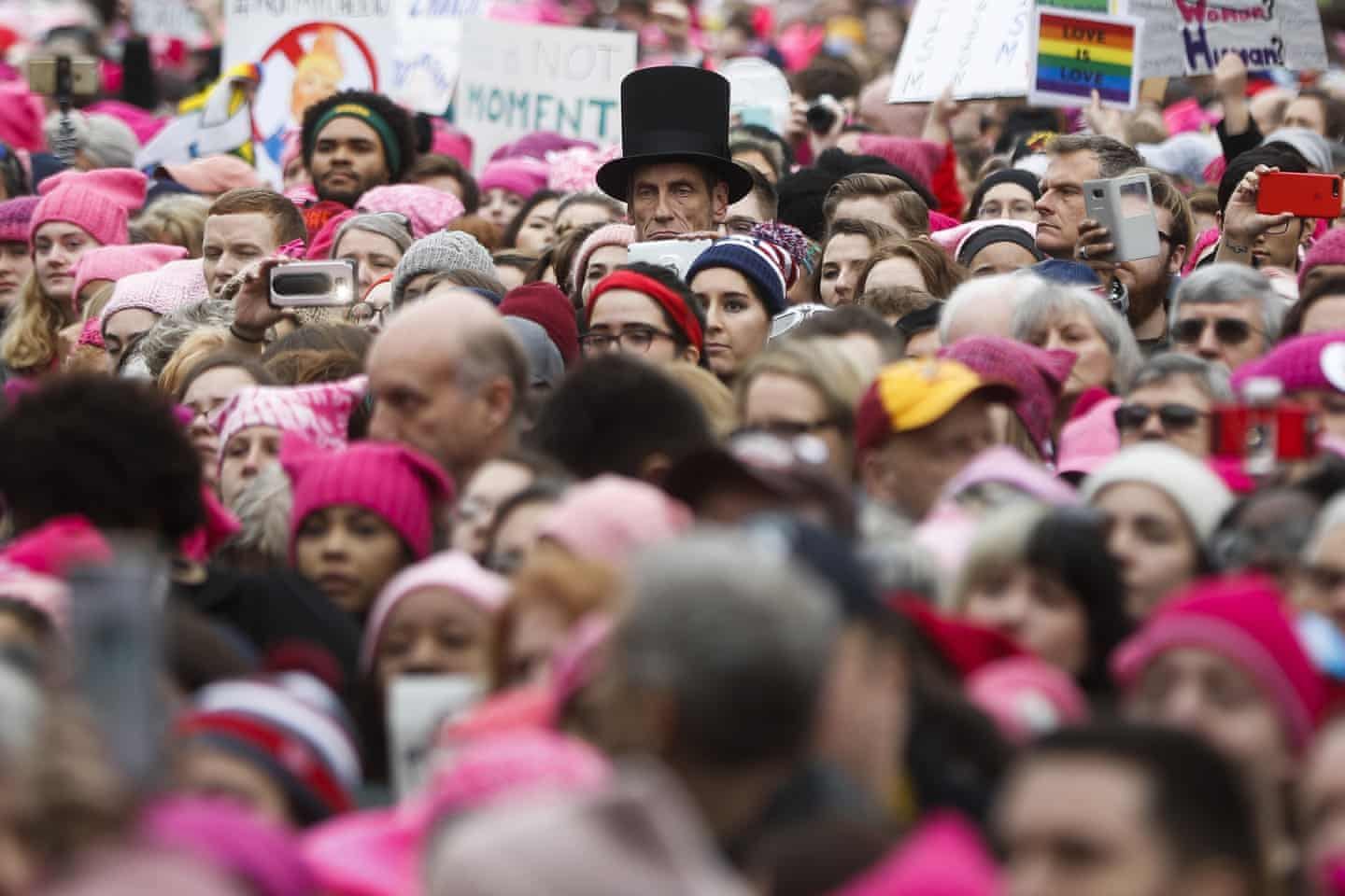 A man dressed as Abraham Lincoln stands with protestors at the Women's March on Washington