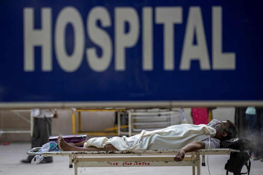A Covid patient waits outside a hospital in Delhi, April 2021.