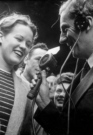 A girl is interviewed on VE Day in London