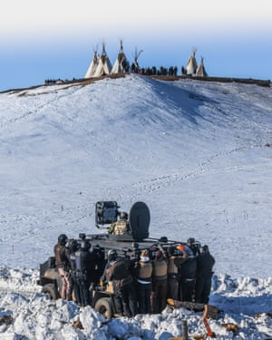 Protesters face off with police and the National Guard on 1 February near Cannon Ball, North Dakota, the main Standing Rock protest camp