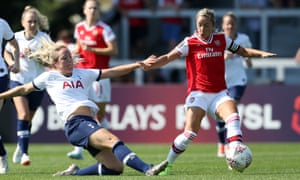 Sophie McClean of Tottenham Hotspur Women slides in on Arsenal's Jordan Nobbs during a pre-season friendly between the north London rivals.