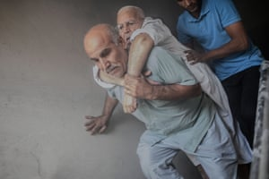 Akçakale, Turkey: an elderly man is evacuated from a building in the town near the Syrian border after it was hit by a rocket reportedly fired from within Syria