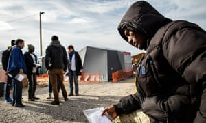 An Eritrean refugee waits for medical attention in 'the Jungle' camp in Calais.