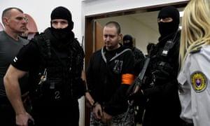 Miroslav Marček arrives in court in Pezinok