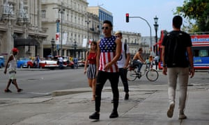 A Cuban wearing a T-shirt with the US flag walks in Havana.