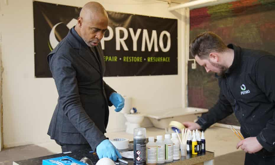 Eric Collins with the lead technician at Prymo.