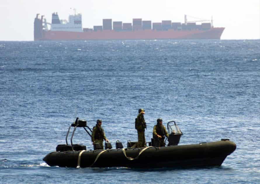 Australian SAS troops with the Tampa in the background, off Christmas Island on 30 August 2001.