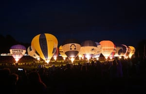 Balloons illuminated by their burners