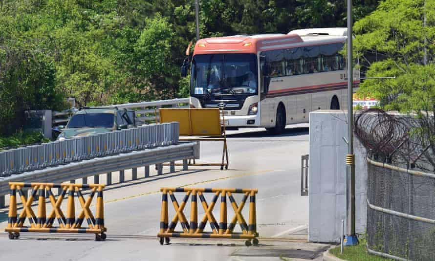 A bus carrying the Women Cross DMZ group at a military checkpoint after crossing the border through the demilitarised zone.