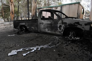 A burnt out ute is seen at a destroyed property in Sarsfield in East Gippsland, Victoria.