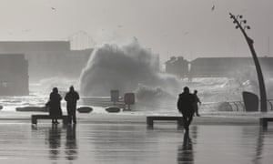High tide and storm surges flood the promenade at Blackpool, England.