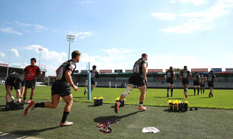 Exeter players take to the Sandy Park pitch for an intra-squad warm-up. The Premiership leaders resume with a home game against Leicester next Saturday.