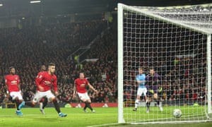 Andreas Pereira of Manchester United scores an own goal to give Manchester City a 3-0 lead