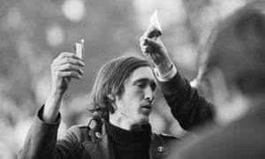 Young men burn their draft cards at an anti-Vietnam war demonstration outside the Pentagon in 1967