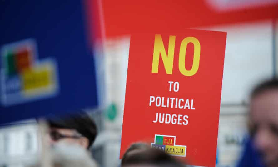 Protests in Warsaw hold campaign placard reading 'No to Political Judges'