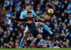 Manchester City's John Stones keeps Arsenal's Alexis Sanchez in check as City stretch their league lead to eight points with a 3-1 win at the Etihad Stadium.