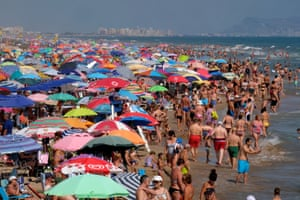Gandia, Spain: people gather on the beach to enjoy the last days of the summer holiday season