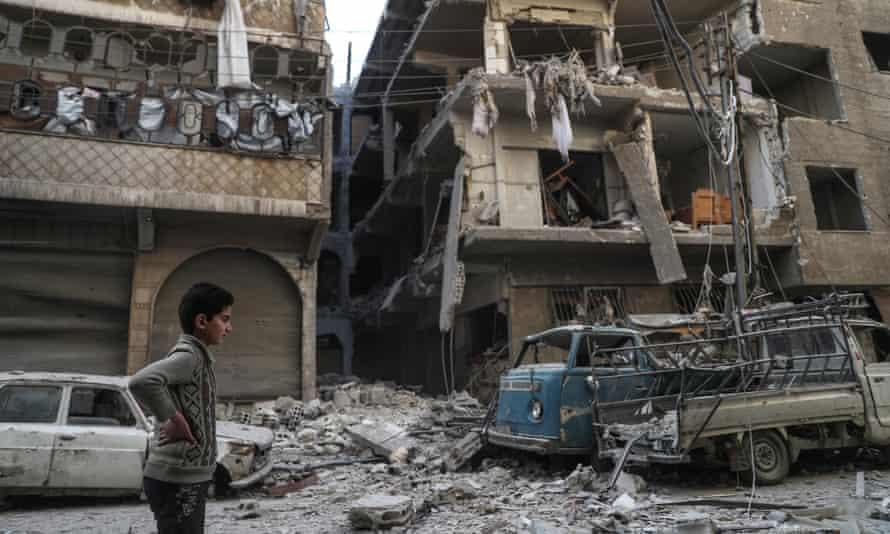 A boy in a damaged street in Douma, Syria