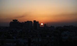 Smoke rises at sunrise after US airstrikes targeting Damascus.