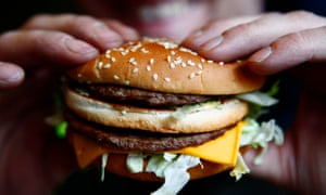 Russell Benjafield holds his Big Mac burger at a McDonald's restaurant in London