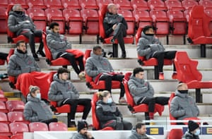 Liverpool splayers watch on from the stand