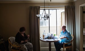 Cid Isbell talks with his stepmother Judy Isbell as he prepares medications and supplements to help him recover from his phalloplasty and scrotoplasty.