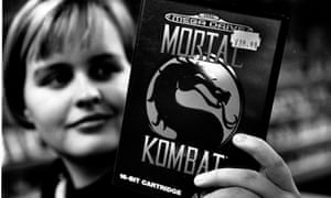A games fan holds a copy of Mortal Combat for the Sega Mega Drive.