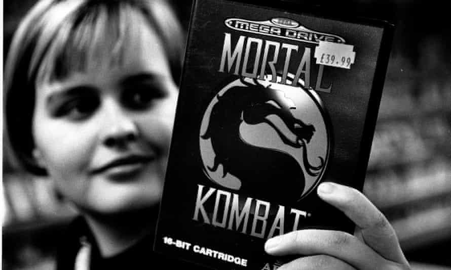 A games fan holds a copy of Mortal Combat for the Sega Mega Drive.