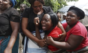 A family member reacts during the funeral of Kelvin Tinashe Choto