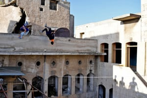 Syrian youths practise parkour in Aleppo, northern Syria
