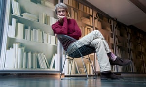 Sir John Hegarty seated in a chair