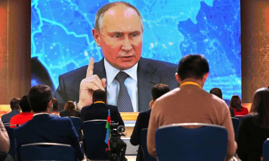 Vladimir Putin speaks via video call during a news conference in Moscow
