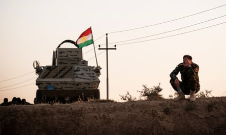A Peshmerga rests on the side of the Hawler - Kirkuk road after his unit fled Kirkuk, following a military operation by the Iraqi Army and Hashd al-Shaabi units to retake the city of Kirkuk.