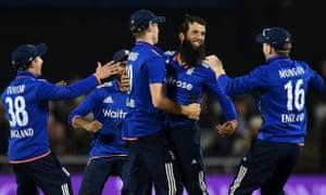 Moeen Ali celebrates taking the wicket of Australia's Glenn Maxwell.
