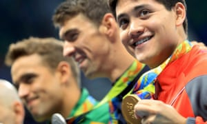 Joseph Schooling poses with his gold medal after winning the men's 100m butterfly final.
