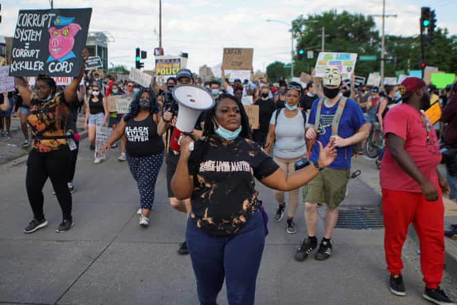 Cori Bush leads a march against the death of George Floyd in June. Bush said in her victory speech: 'We decided that we the people have the answers, and we will lead from the front lines.'