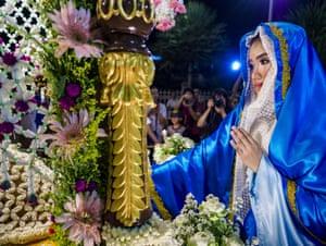 A woman representing Mary, the Mother of Jesus, prays at Santa Cruz Church, Bangkok.