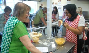 Pupils and local seniors take part in a wartime cooking sessions at The Radclyffe School, Oldham.