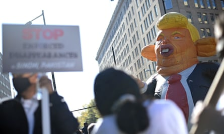 Protesters carry an effigy of US President Donald Trump as they demand that every vote be counted during a rally in Washington DC.