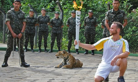 A jaguar, who lived in a local zoo, is used as part of an Olympic torch ceremony in Manaus. Shortly afterwards she was dead, killed by a soldier's bullet.