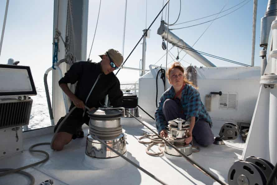 Luca Lamont, a volunteer deckhand from Byron Bay, learns the ropes from Manuel Marinelli on the Rainbow Warrior III