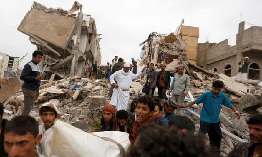 The body of woman is carried away from a house destroyed by a Saudi-led airstrike in Sanaa, Yemen, in August 2017.