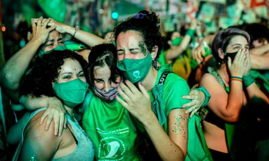 Pro-choice activists celebrate in Buenos Aires after politicians approved a bill to legalise abortion.