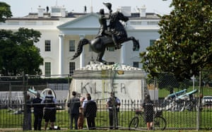 The word 'killer' is seen on a statue of Andrew Jackson across from the White House in Washington DC, on 23 June.