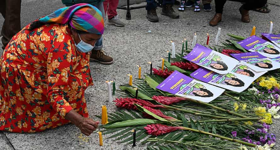 A member of the Civic Council of Popular and Indigenous Organizations of Honduras (Copinh) lights a candle after the verdict.