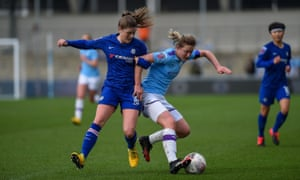 Ellen White of Manchester City shields the ball from Chelsea's Maren Mjelde. City are currently one point ahead of Chelsea in the WSL.