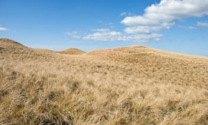 Sand dunes of Sandwood Bay Scotland taken on sunny day with blue sky