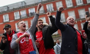 Liverpool fans get into the swing of things in Plaza Mayor in Madrid on Tuesday afternoon.