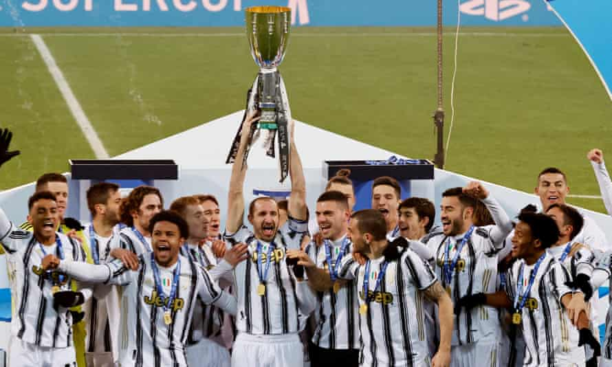 Juventus and Cristiano Ronaldo (top right) celebrate the Italian Super Cup triumph.