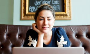 Woman looking at screen in cafe.